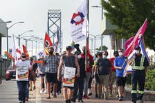 Members of the Customs and Immigration Union and their supporters participate in a rally near the Ambassador Bridge in Windsor on Wednesday, August 4, 2021.
