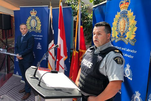 RCMP Staff Sgt. Adam Palmer (left), of the RCMP's Newfoundland and Labrador federal serious and organized crime unit, and Sgt. Kenneth Maher, district commander for the RCMP in the Trinity-Conception area, at a news conference Aug. 4 at RCMP Headquarters in St. John's. Joe Gibbons • The Telegram
