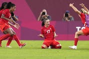 Canada's Jessie Fleming, 17, celebrates scoring the opening goal from the penalty spot during a women's semifinal soccer match against United States at the 2020 Summer Olympics, Monday, Aug. 2, 2021, in Kashima, Japan.