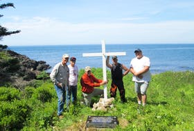 """A 2019 refurbishment of the memorial at Riley's Cove for those who perished from the SS Robert G. Cann in 1946. (From Left to Right) Craig Stencil, visiting from Texas and Chip's brother-in-law; Jerry Titus of Yarmouth; Manning """"Chip"""" Gasch of Trout Cove, Digby County; Craig Pyne of Centreville, Digby County and Jesse Gidney of Centreville, Digby County. CONTRIBUTED"""