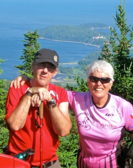 Paul MacDougall and Micheline Guillot at top of Franey Mountain overlooking Middle Head, during the first Ingonish Bike and Hike in 2014. Contributed • Jacques Coté