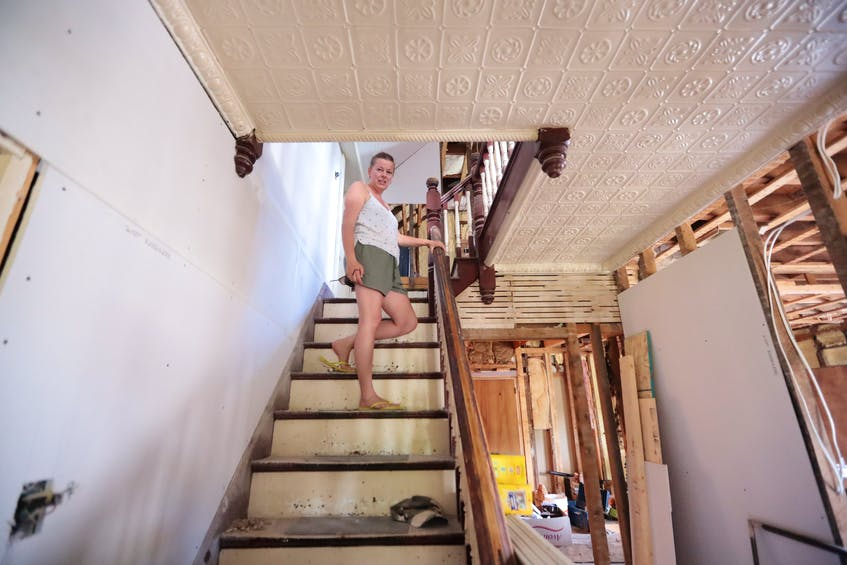 Marlies van Sloten on the main stairs. The tin ceiling above is one of the charms of the house she loves the most. - Eric Wynne