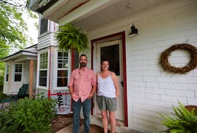 Marlies Van Sloten and Andrew Skowby in front of the formerly abandoned home in Springfield.