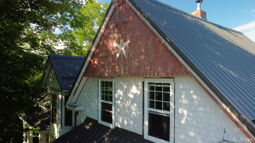 One of the first major projects was installing a new roof on this old house in Springfield. - Eric Wynne