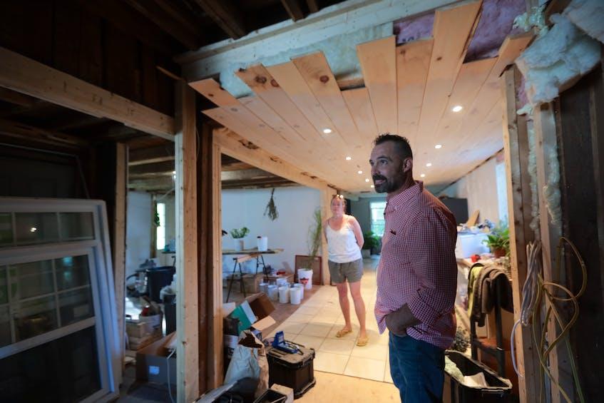 Marlies van Sloten and Andrew Skowby inside the kitchen still in progress. - Eric Wynne