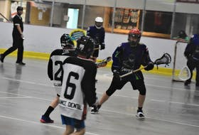 Pictou County U-13 Snipers player William Hussey prepares to defend a Bearcats' attack during recent Scotia Minor Lacrosse League action in Truro.