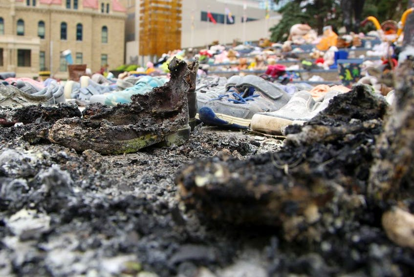 Calgary police are investigating a small fire that occurred at the residential school memorial outside city hall last night. Wednesday, August 4, 2021. Brendan Miller/Postmedia