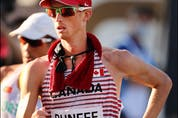 SAPPORO, JAPAN – AUGUST 06: Evan Dunfee of Team Canada competes in the Men's 50km Race Walk Final on day fourteen of the Tokyo 2020 Olympic Games at Sapporo Odori Park on August 06, 2021 in Sapporo, Japan.