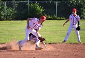 Bearcats' shortstop Malky Murphy takes the throw from his catcher but a little too late to catch the Halifax Mets' runner. Also pictured from Truro is second baseman Ryan Jollimore.