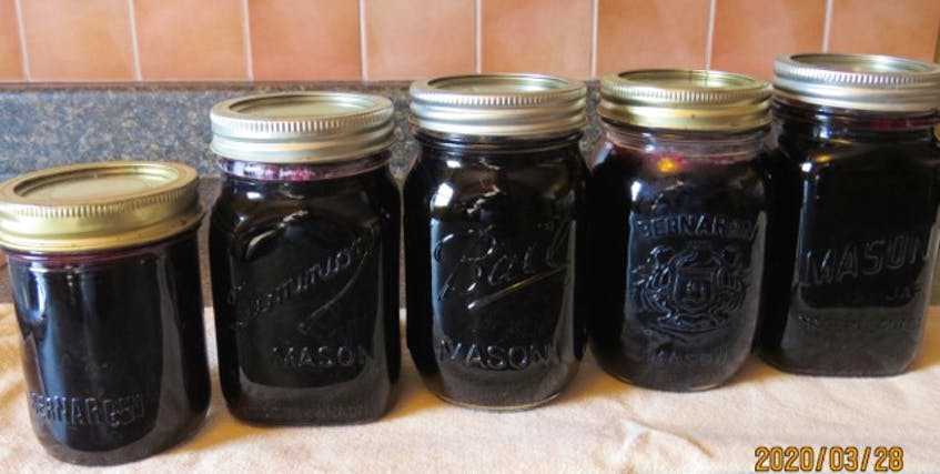 These pictures show some of the steps in making jelly: from fresh currants cooked with water in a stockpot, top left, to the cooked pulp strained through cheesecloth, top right, to the juice that will be used for jelly, bottom left. The end result is bottled jelly ready to enjoy. - Contributed
