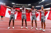 Aaron Brown, Jerome Blake, Brendon Rodney and Andre De Grasse of Canada celebrates after winning bronze in the men's 4x100m relay at the 2020 Tokyo Olympics.