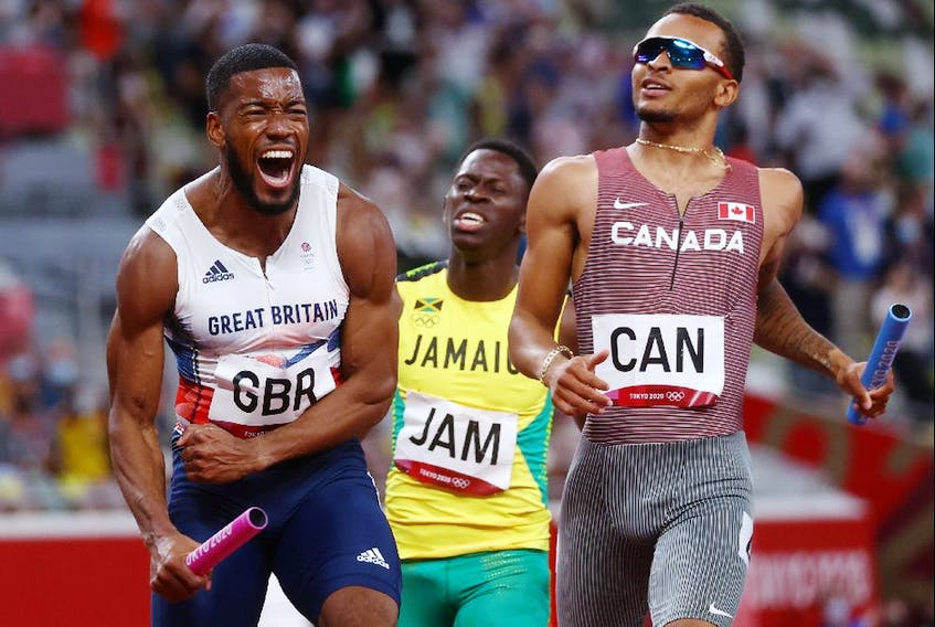 Nethaneel Mitchell-Blake of Britain crosses the line to win silver ahead of Andre De Grasse of Canada.
