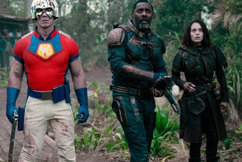John Cena as Peacemaker, Idris Elba as Bloodsport and Daniela Melchoir as Ratcatcher 2 in The Suicide Squad.