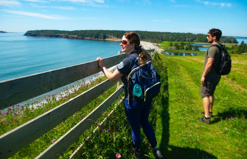 Jaimee Dupont Morozoff, Nova Scotia director for the Nature Conservancy of Canada, looks out on Hirtle's Beach before heading out to the Gaff Point trailhead. - Ryan Taplin