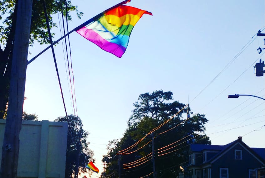 Pride flags fly high on Main Street in Annapolis Royal in preparation for the town's annual pride parade, which will be held this Saturday, Aug. 7.