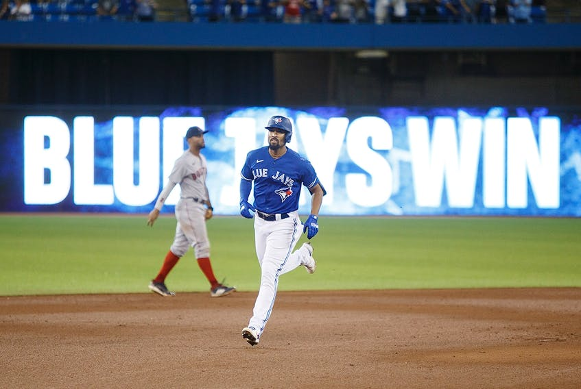 Marcus Semien of the Toronto Blue Jays rounds the bases after he hit a walk-off home run against the Boston Red Sox at Rogers Centre on August 7, 2021.