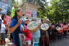 A Mi'kmaw honours song is performed at a rally against the sale of lands in the former Owls Head provincial park in downtown Halifax on Saturday, Aug. 7, 2021.