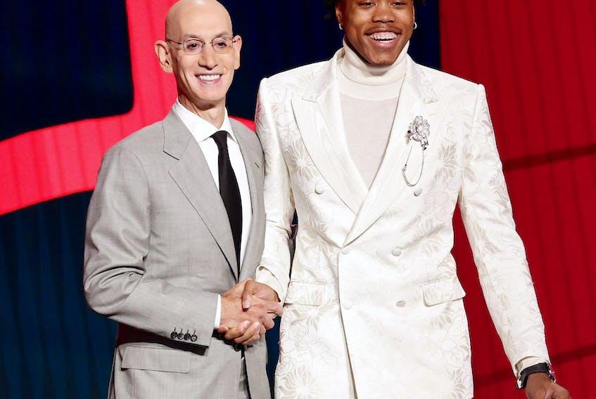 NBA commissioner Adam Silver (left) and Scottie Barnes pose for photos NBA commissioner Adam Silver (left) and Scottie Barnes pose for photos at the 2021 NBA Draft