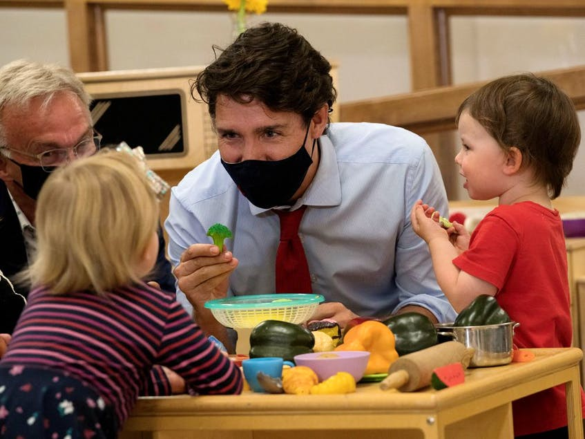 Canada's Prime Minister Justin Trudeau plays with children at the daycare in Carrefour de l'Isle-Saint-Jean school in Charlottetown, Prince Edward Island last month. Ottawa has pledged to give parents access to $10-per-day child care within five years. - Reuters/John Morris/File Photo