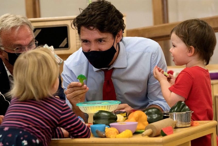 Canada's Prime Minister Justin Trudeau plays with children at the daycare in Carrefour de l'Isle-Saint-Jean school in Charlottetown, Prince Edward Island last month. Ottawa has pledged to give parents access to $10-per-day child care within five years.