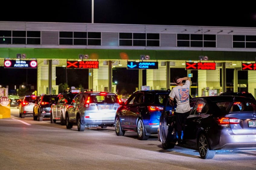 A backed-up Canada/U.S. border crossing. - Reuters