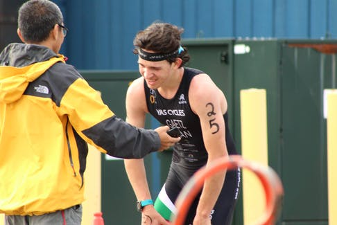 An exhausted Roughan Gaetz is congratulated by coach Mike On after winning the sprint draft legal triathlon during the sixth annual Tri-Lobster Triathlon in Summerside Sunday morning. Gaetz, 17, raced out of St. John's, N.L.
