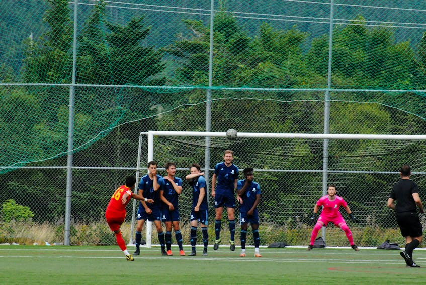 In this first-half Challenge Cup men's soccer action in Mount Pearl on Sunday afternoon, Owen Sheppard, 16, of Holy Cross, kicks the ball towards the Feildian's goal and keeper Logan Walsh on a penalty kick, but it sailed over the crossbar. Feildian's lead 1-0 after the first-half on an Emmanuel Dolo goal at the 43-minute mark. They went on to win 3-0, with Dolo getting a hat-trick, marking the first loss of the season for the Holy Cross Kirby Group squad. -Joe Gibbons/The Telegram