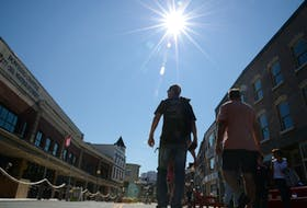 People visiting the pedestrian mall in downtown St. John's enjoy a sunny day as they take in the sights, sounds and smells of the outdoor eateries Monday, Aug. 9. Keith Gosse • The Telegram