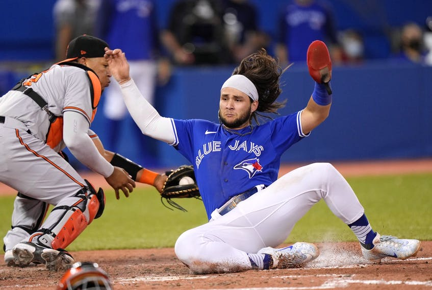 Toronto Blue Jays shortstop Bo Bichette scores as Baltimore Orioles catcher Pedro Severino misses the tag in the sixth inning at Rogers Centre in Toronto Blue Jays shortstop Bo Bichette scores as Baltimore Orioles catcher Pedro Severino misses the tag in the sixth inning at Rogers Centre in Toronto on Aug. 31, 2021.