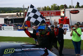 Craig Slaunwhite celebrates after winning the Wilson Equipment Twin 75s at Riverside Speedway on Aug. 21.