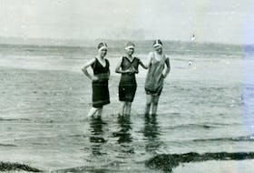 Three young women show off their 1930s-era swimsuits while wading in the water at Nelgah Beach. CONTRIBUTED • BEATON INSTITUTE DIGITAL ARCHIVES