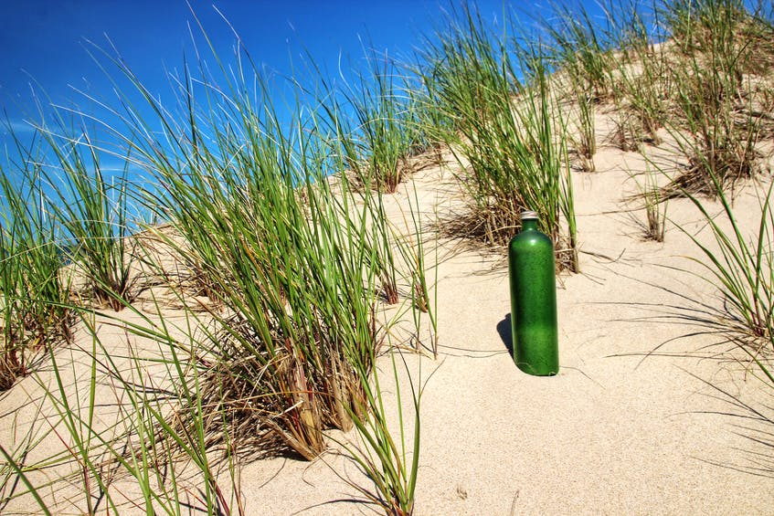 Fifty years ago, Darcy Rhyno's father collected a bottle of Sable Island sand during a visit to the island. He died a few years later. Rhyno intended to return the sand to Sable Island during a recent visit. - Darcy Rhyno