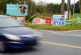 With a mix of federal and municipal election signs, this crowded spot in Mount Pearl might be a bit confusing for some voters.  Keith Gosse/The Telegram