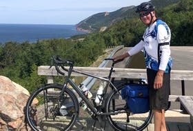 hris MacInnis of Coxheath stopped for a break during his annual bike trip of the Cabot Trail. MacInnis recently completed his 45th trip around the trail, a feat dating back to 1976. CONTRIBUTED • JOHN MACINNIS