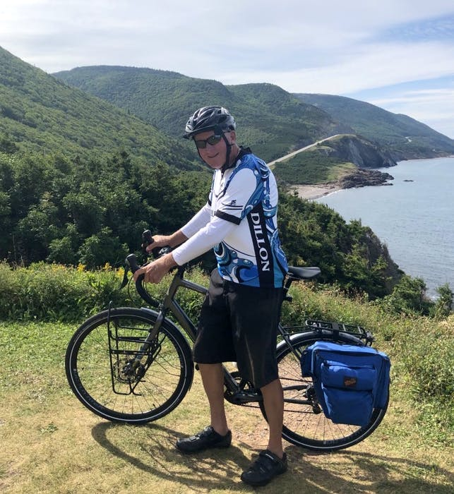Chris MacInnis of Coxheath with his bicycle overlooking a section of the Cabot Trail on Monday. The 70-year-old retired educator recently completed his 45th year cycling the Cabot Trail. CONTRIBUTED • JOHN MACINNIS