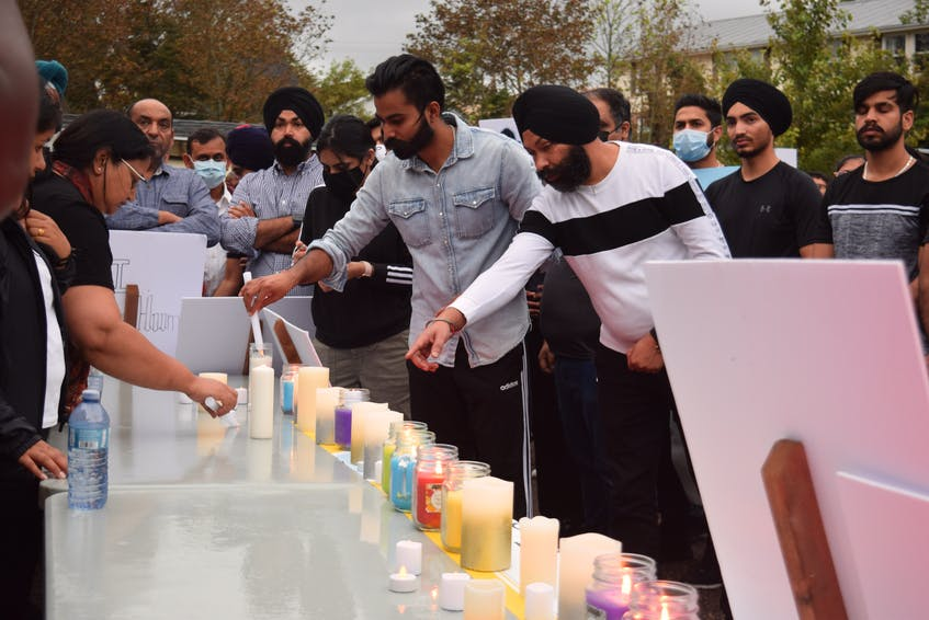 Candles and flowers were laid in memory of Prabhjot Singh Katri. - Chelsey Gould