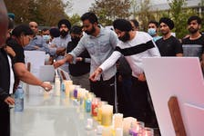 Candles and flowers were laid in memory of Prabhjot Singh Katri.
