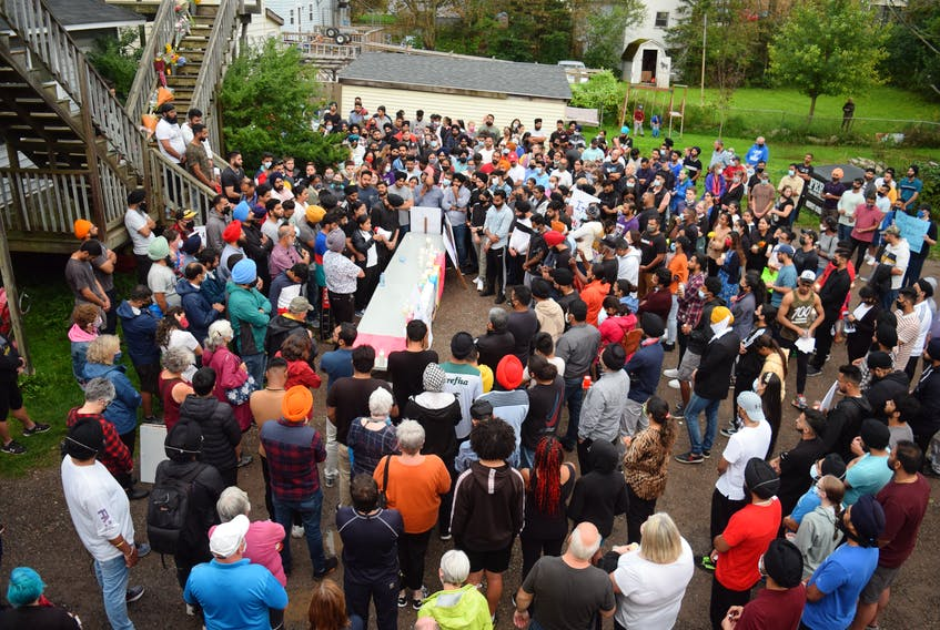 Several hundred people gathered and shared words Friday at the site in Truro where Prabhjot Singh Katri was fatally wounded Sept. 5.