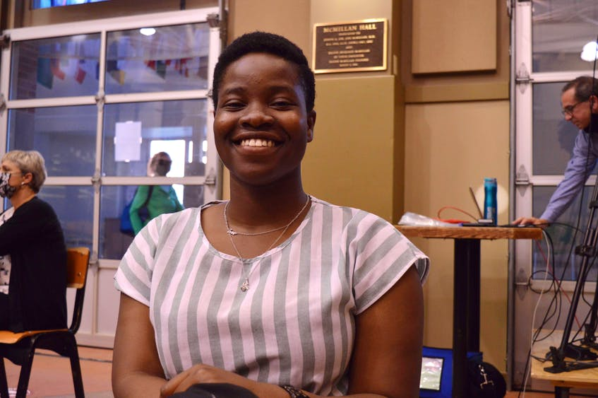 Tolulope Oginni, an international student at UPEI,  attends the Charlottetown candidates' debate Sept. 8 to learn more about the parliamentary system of government. - Alison Jenkins