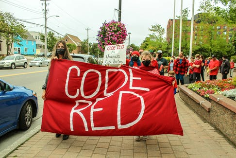 The Climate Change Taskforce of Cape Breton held a 'Code Red' climate rally in Sydney on Friday ahead of the federal election on Sept. 20 and the COP26 summit in November. The rally, which included Cape Breton Regional Municipality Mayor Amanda McDougall, walked from City Hall on Esplanade to the New Dawn Lawn on Nepean St. JESSICA SMITH/CAPE BRETON POST