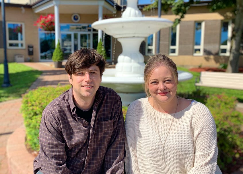 SaltWire reporter Andrew Waterman sits with longtime friend Ashley Harris outside Gander Town Hall. Both were in Grade 10 when the terrorist attacks on the World Trade Center resulted in 38 planes being diverted to the Gander airport. - Andrew Waterman