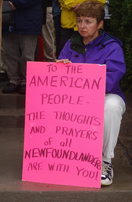 A woman holds up a sign welcoming stranded passengers to St. John's on Sept. 11, 2001. - Joseph Gibbons