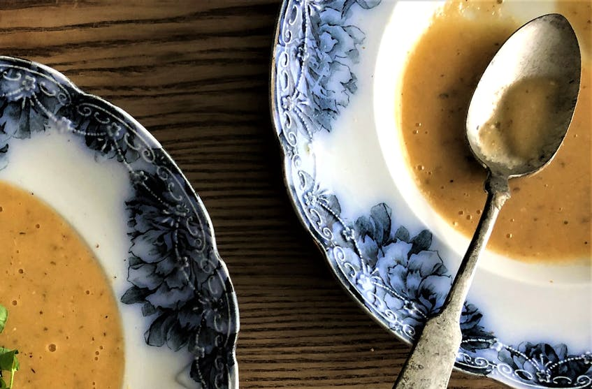 Mark DeWolf creates an intensely flavourful soup from roasted garlic and stale bread. - Supplied