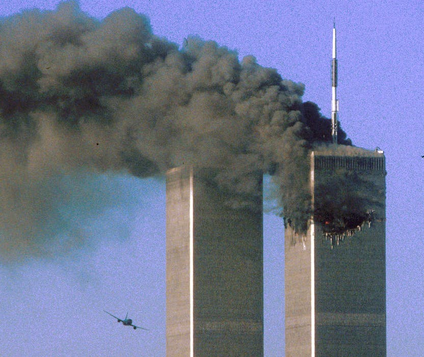Hijacked United Airlines Flight 175 flies toward the World Trade Center twin towers shortly before slamming into the South Tower  as the North Tower burns, following an earlier attack by a hijacked airliner in New York, N.Y., on Sept. 11, 2001. REUTERS/Sean Adair/File Photo  - REUTERS