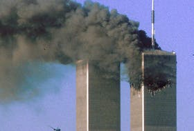 Hijacked United Airlines Flight 175 flies toward the World Trade Center twin towers shortly before slamming into the South Tower  as the North Tower burns, following an earlier attack by a hijacked airliner in New York, N.Y., on Sept. 11, 2001. REUTERS/Sean Adair/File Photo