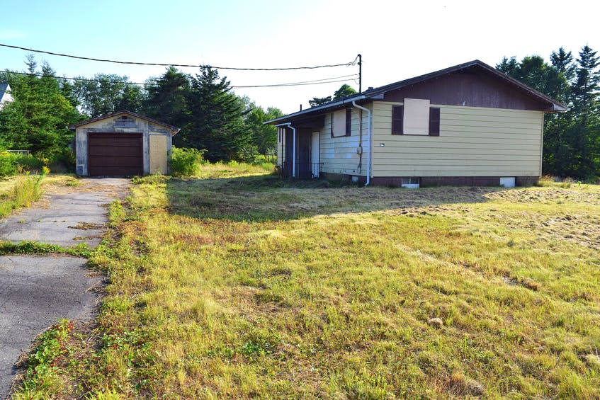 The owner of this house at 15 Cameron's Lane, New Victoria, says a mistake in the deed resulting in three relatives being listed on it and one refusing to sign off, has left his family home deteriorating for nine years and is now about to be demolished by the CBRM. Sharon Montgomery-Dupe/Cape Breton Post - Sharon Montgomery