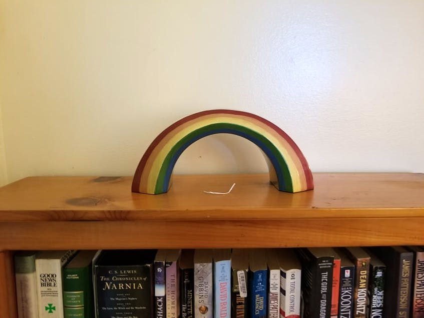 In honour of where he came from, Kitty's urn is a rainbow – much like the old arch outside Rainbow Valley. Underneath Kitty's urn is a twist tie; he loved playing with them while he was alive, said his owner, Shannon Stewart. - Contributed