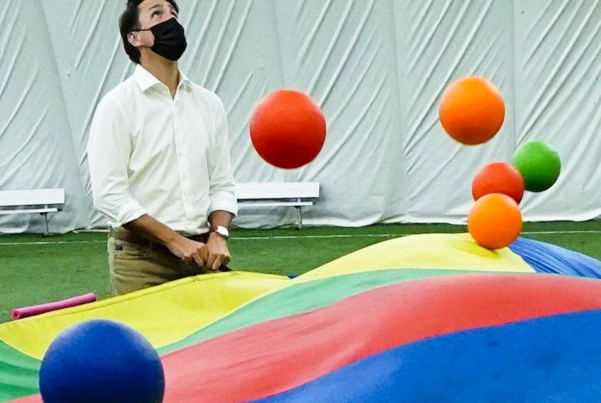 Liberal Leader Justin Trudeau plays parachute with youngsters as he makes a campaign stop at Soccer World in Hamilton, Ont., on Friday, Sept. 10, 2021.