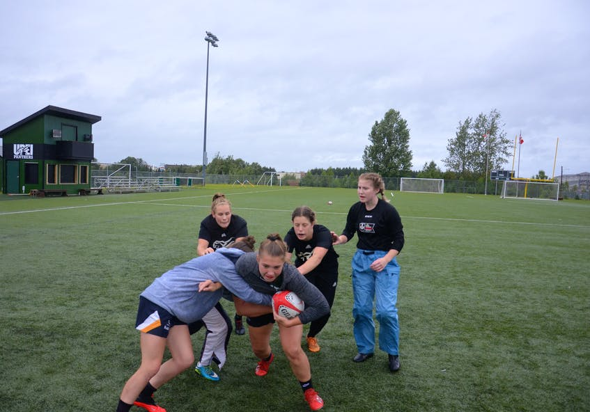 Kristi Stewart carries the ball while Mackenzie Hale, left, assists Olivia McLeod in making the tackle during a recent practice for the UPEI women's rugby team. Following the ball in the back, from left, are Sophie Carragher, Agustina Cohen and Julia Freeburn. The Panthers play their first game of the 2021 regular season against the St. Francis Xavier X-Women at UPEI on Sept. 11 at 2 p.m. - Jason Simmonds