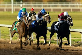 Regal Max ridden by Edgar Zenteno (third from right) hits the gas to win the Allowance Optional Claiming race during the 91st Canadian Derby at Century Mile racetrack in Nisku south of Edmonton, on Sunday, Sept. 27, 2020. Real Grace went on to win the Canadian Derby later in the evening.